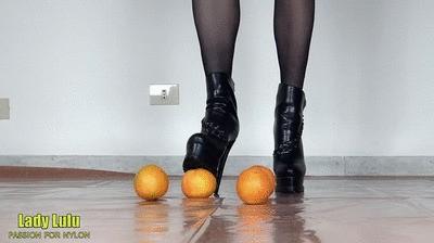 Oranges under the black high-heeled booties