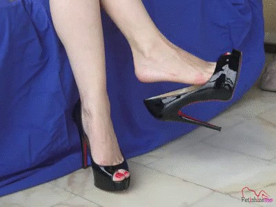 Angie dangling her luxurious classy well known brand peep toe