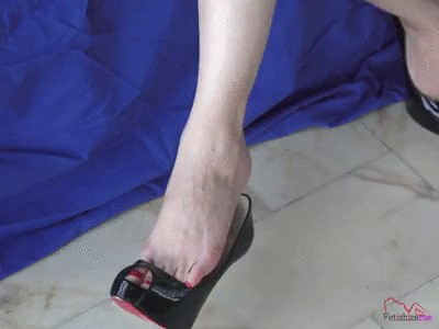 Ms Angie dangling and tapping the tip of her heels (upper POV)