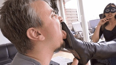 Slave licks the street dirt from my boots