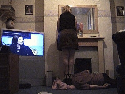 Lisa Doing Her Hair In The Mirror Whilst Stepping On Her Slave