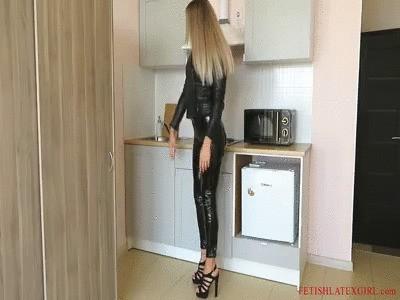 Lovely blonde Bella in vinyl leggings walks around the room