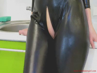 Big booty redhead Monica in black catsuit shows off her charms