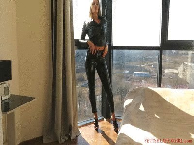 Blonde Bella in vinyl leggings posing in the room and on the bed