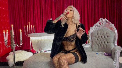 Smoking 2 cigaretes at once in fur and lingerie